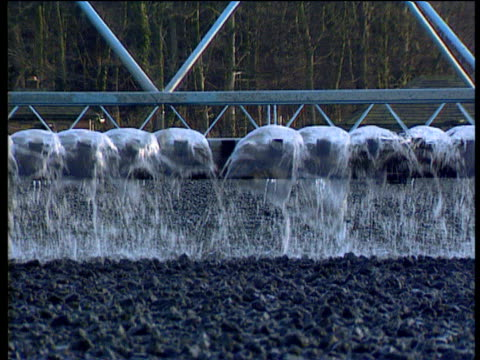 Water sprinklers zoom out to vast clinker bed at sewage works
