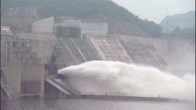 water spurts from xiaolangdi dam, china - hydroelectric power stock videos and b-roll footage