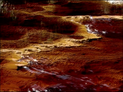 water stained red by mineral ores (iron & other minerals very high ph), rio tinto, huelva, andalusia, spain - groundwater stock videos and b-roll footage