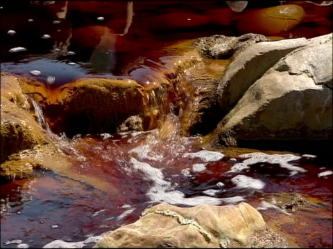 water stained red by mineral ores (iron & other minerals very high ph), rio tinto, huelva, andalusia, spain - huelva province stock videos & royalty-free footage