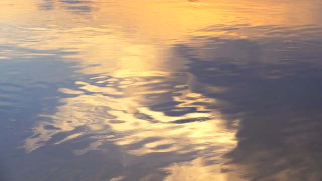 4k: water surface at sunset - surface level stock videos & royalty-free footage