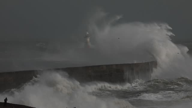 water surrounds a lighthouse as waves crash against the harbour wall during storm francis on august 25, 2020 in newhaven, england. the met office... - wave stock videos & royalty-free footage