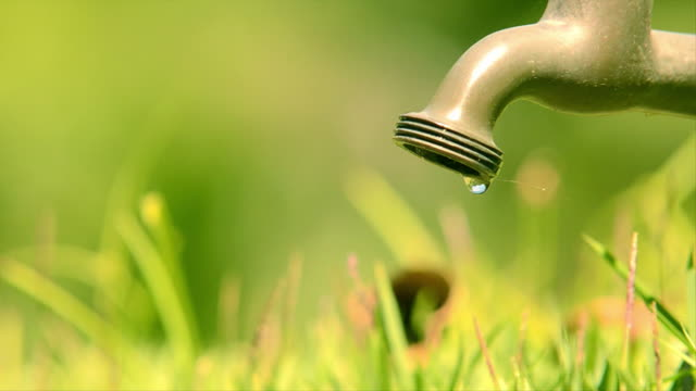 water tap leaking - water conservation stock videos & royalty-free footage