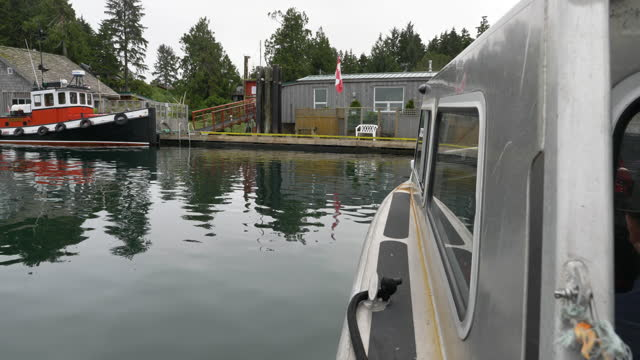 water taxi pov as it approaches pier on meares island, british columbia - water taxi stock videos & royalty-free footage