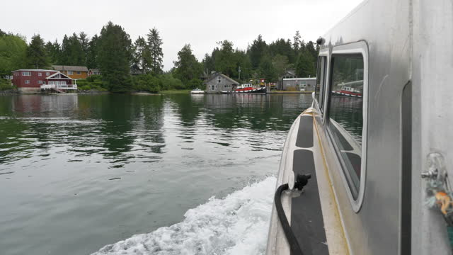 water taxi pov as it approaches shore on meares island, british columbia - water taxi stock videos & royalty-free footage