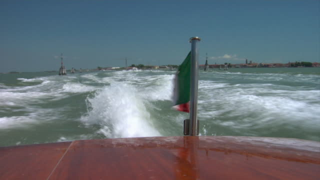 rear pov, water taxi crossing venice lagoon, venice, italy - water taxi stock videos & royalty-free footage