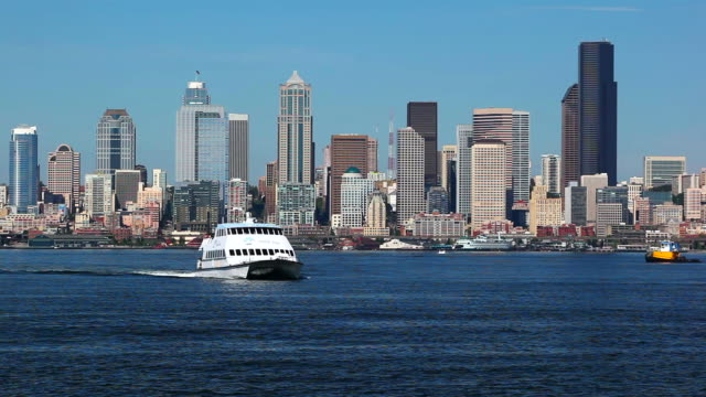 ws water taxi on elliott bay with skyline in background / seattle, washington, usa - water taxi stock videos & royalty-free footage