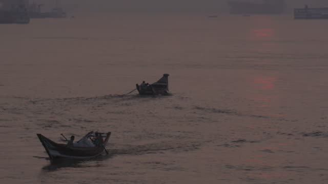 Water taxi rides off into sunset in Myanmar