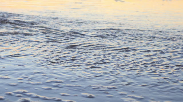 water texture at sunset - flowing water stock videos & royalty-free footage