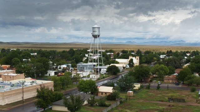 water tower above marfa, tx - descending drone shot - small town america stock videos & royalty-free footage