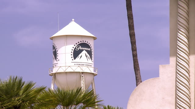 ws zo water tower with paramount mountain logo to main gate of paramount studios at 5555 melrose avenue / hollywood, california, usa  - paramount studios stock videos & royalty-free footage