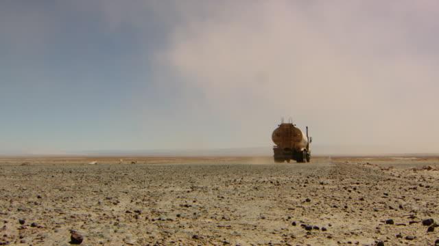 Water Transporter driving thorugh the Atacama desert