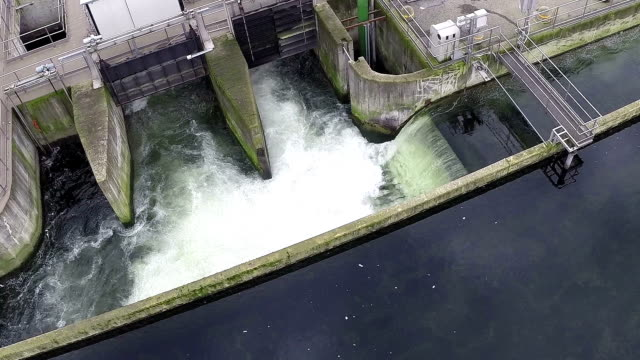 water treatment waterfall (aerial drone video) - storage tank stock videos & royalty-free footage