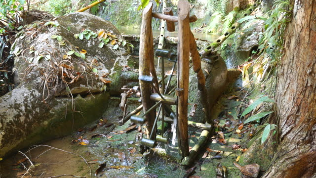 water wheel in tropical forest, watermill - watermill stock videos & royalty-free footage