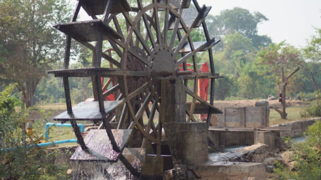 water wheel turning slowly through water - water wheel stock videos and b-roll footage
