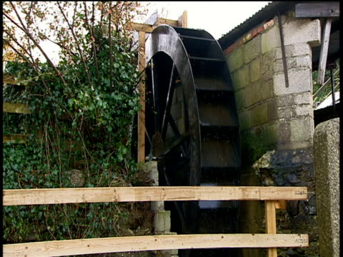 water wheel turns generating renewable electricity cornwall - water wheel stock videos and b-roll footage