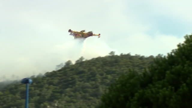 Waterbomber planes attempting to put out wildfires in BormesLesMimosas France