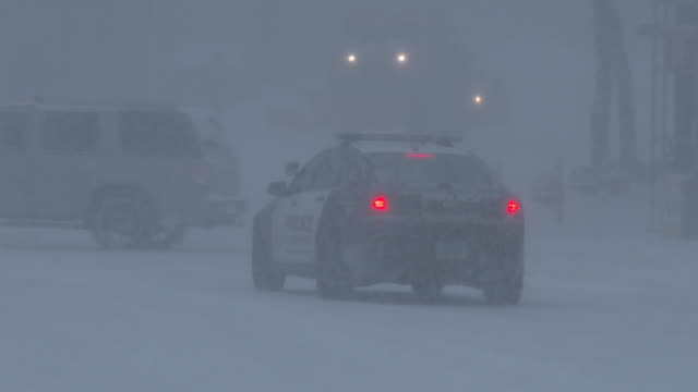 A Waterbury Connecticut Police vehicle patrols the streets as heavy blowing snow creates dangerous travel conditions during an intense blizzard