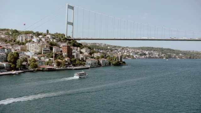 aerial watercraft on the bosphorus straits and villas beneath the bosphorus bridge / istanbul, turkey - july 15 martyrs' bridge stock videos & royalty-free footage