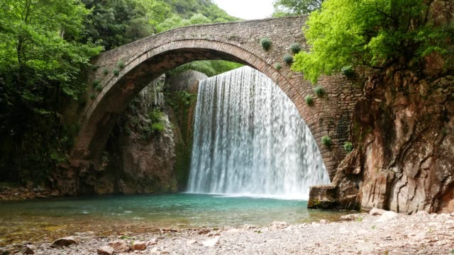 Waterfall, and an Ancient Roman Bridge, Close-up. Amazing Aerial View of a Majestic, Peaceful, Idyllic Nature scene, Famous Places in Greece, travel destinations, movie shot, meditation, Japan