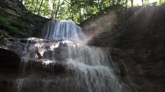 a waterfall cascades at sherman falls in hamilton, ontario, canada. - ontario canada stock videos & royalty-free footage