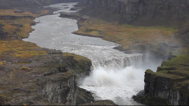 A waterfall downstream from Dettifoss that is fed by glacial meltwater from the Vatnajokull Ice Cap, Iceland.