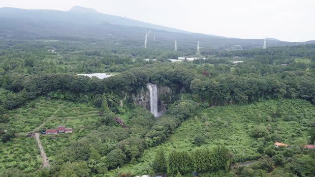 waterfall falling in mountain / jeju-do, south korea - wide stock videos & royalty-free footage