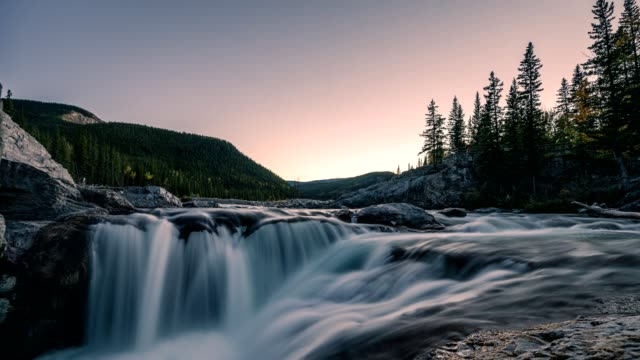 waterfall flowing on rocks in pine forest on evening at elbow falls - flowing water stock videos & royalty-free footage