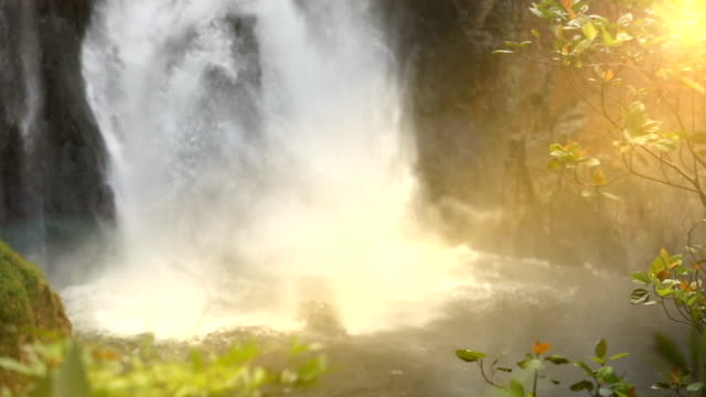 waterfall in a deep forest ( with sound),slow motion