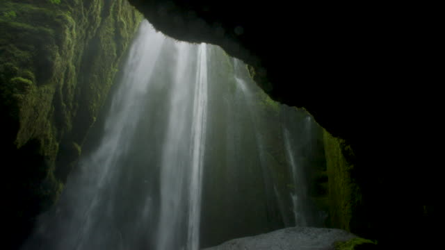 waterfall in mossy cavern - falling water stock videos & royalty-free footage