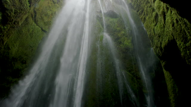 waterfall in mossy cavern - low angle view stock videos & royalty-free footage