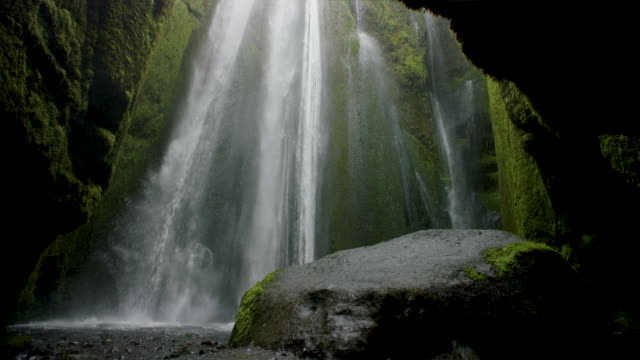 waterfall in mossy cavern - waterfall stock videos & royalty-free footage