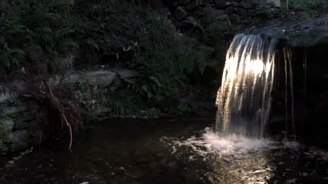 waterfall in the garden - building feature stock videos & royalty-free footage