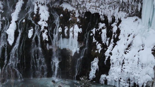 waterfall in winter landscape, high angle - kamikawa subprefecture stock videos and b-roll footage