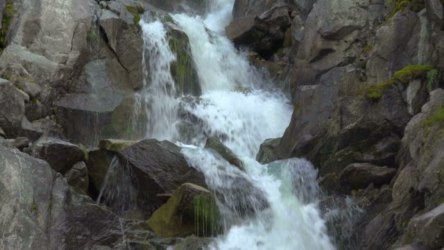 waterfall of a mountain brook at furka pass road, canton of uri, switzerland - bach stock-videos und b-roll-filmmaterial
