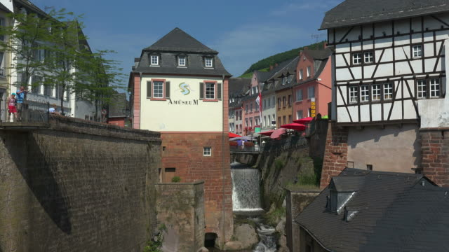 waterfall of leukbach river in the old town of saarburg, rhineland-palatinate, germany, europe - timber stock-videos und b-roll-filmmaterial