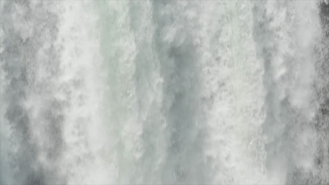 a waterfall on a river. - slow motion - waterfall stock videos & royalty-free footage