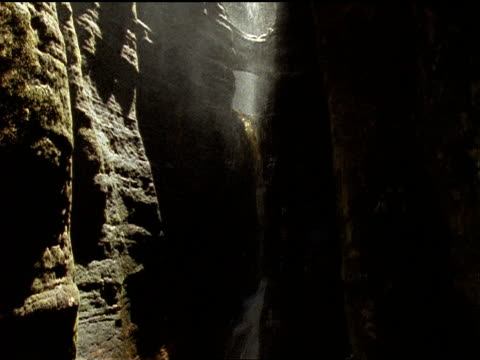 a waterfall pours into a narrow, deep canyon. - narrow stock videos & royalty-free footage