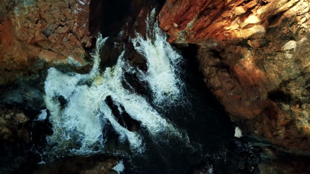 waterfall surrounded by rocks. aerial view - mountain range stock videos & royalty-free footage