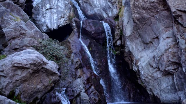 Waterfall surrounded by rocks
