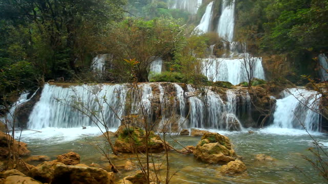 waterfall theelorsu in deep forest - recreational horse riding stock videos & royalty-free footage