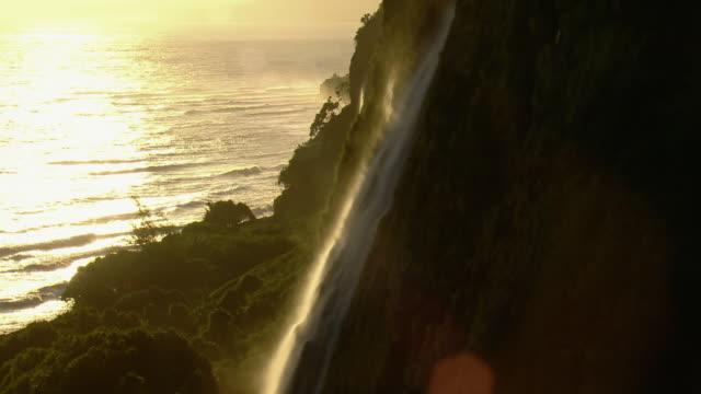 Waterfalls cascade toward the ocean on Hawaii's Hamakua Coast.