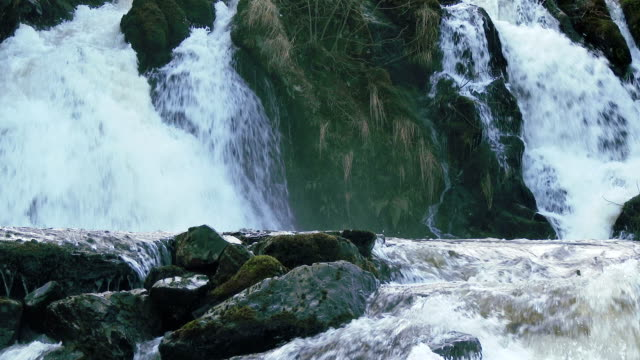 waterfalls in a rural setting in dumfries and galloway, scotland - dumfries and galloway stock videos & royalty-free footage