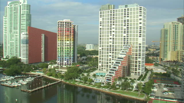 AERIAL Waterfront apartment buildings and hotels, yachts in marina / Miami, Florida, USA