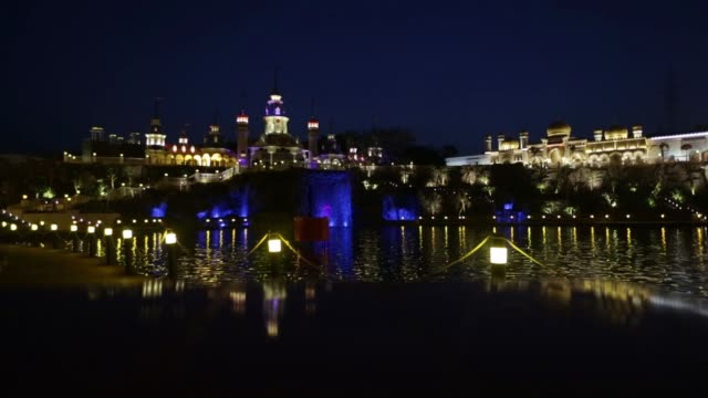 Waterfront area by the Imagica Capital building left and the Alibaba Aur Chalis Chorr ride at Adlabs Imagica theme park operated by Adlabs...