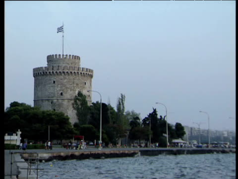 waterfront area with white tower in thessaloniki - thessalonika stock videos & royalty-free footage