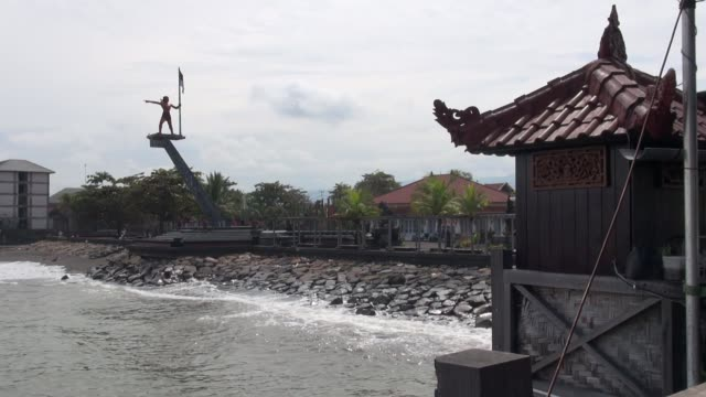 waterfront at singaraja town in north bali featuring statue of freedom fighter yudha mandala tama who was killed by gunfire from a dutch warship... - north bali stock videos & royalty-free footage