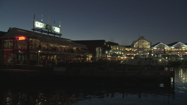 WS PAN Waterfront buildings illuminated at dusk, Cape Town, Western Cape, South Africa