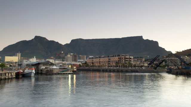T/L Waterfront in Cape Town, Table Mountain in background, day to night, South Africa