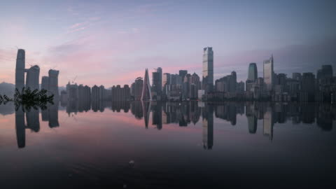 waterfront reflection of urban city downtown sunrise to day transition - raffles city stock videos & royalty-free footage